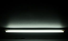 Detail of a fluorescent tube. Detail of a fluorescent light tube on a wall. fluorescent light tube with copyspace for any design royalty free stock image