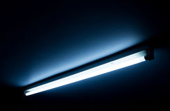 Detail of a fluorescent tube. Mounted on a wall, false green color light stock photos