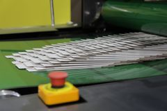 detail of a folder gluer machine stock photos