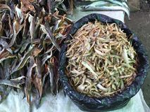 Detail of food in a street market. Detail of dried fish in a straw tray from a burma street market stock photo