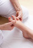 Detail foot reflexology massage Royalty Free Stock Photos