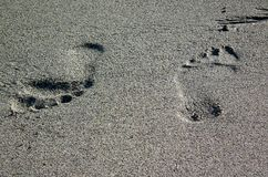 Footprints crossed in the sand. royalty free stock image