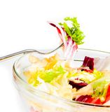Detail of fork on italian fresh salad on white Royalty Free Stock Images