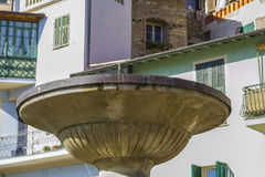 Detail of a fountain in Dolceacqua Imperia, Liguria, Italy. A typical medieval village in the Ligurian hinterland not far from the border with France, which stock photos