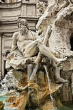 Detail of the. Fountain of the Four Rivers, showing the rivergod Ganges, Piazza Navona, Rome, Italy Stock Photo