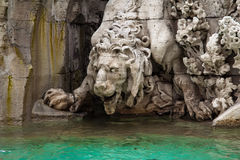 Detail of the. Fountain of the Four Rivers, statue of the lion, Piazza Navona, Rome, Italy Stock Photography