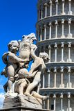 Detail of the Fountain Putti Fountain and the Leaning Tower of Pisa at the Piazza dei Miracoli in Pisa, Tuscany, Italy royalty free stock photo