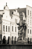 Detail of fountain in Telc, Czech republic. Detail of fountain at the main square of Telc, Czech republic - sepia color image Stock Images