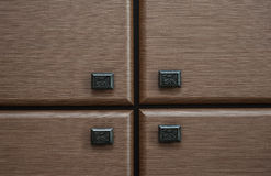 Detail of four wooden drawers with metal handles Royalty Free Stock Photography