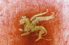 Detail of the fresco in Pompeii with winged griffin on a red bac Stock Image