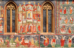 Detail of the fresco of Voronet monastery. Detail of a painted wall and two windows of Voronet Monastery, Bucovina Royalty Free Stock Photography