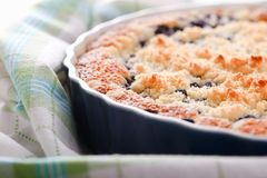 Detail of fresh blueberry pie in blue baking dish stock images