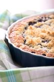 Detail of fresh blueberry pie in blue baking dish on towel Royalty Free Stock Photo