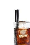 Detail of fresh coke with black straw, summer time Royalty Free Stock Photography