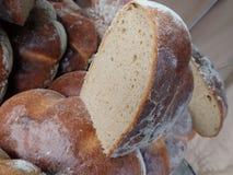 Fresh homemade baked bread in abundance. Detail of a fresh homemade baked bread in abundance royalty free stock images