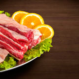Detail of fresh and raw meat. Ribs and pork chops uncooked, uncu. Fresh and raw meat. Ribs and pork chops uncooked, uncut ready to grill and barbecue with Royalty Free Stock Image