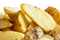 Detail of fried american potato wedges on white. Stock Photo