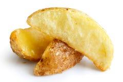 Detail of fried potato wedges isolated on white. Stock Image