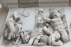Detail of the frieze of the Pergamon Altar in the Pergamon Museu Stock Image