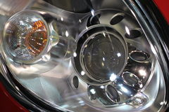 Detail of front headlight on car. Royalty Free Stock Image