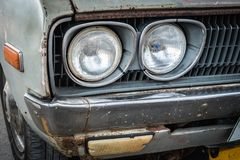 Detail of the front headlight of an old car Royalty Free Stock Photo