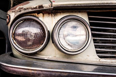 Detail of the front headlight of an old car Stock Photos