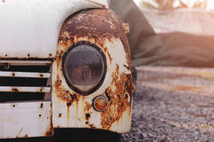 Detail of the front headlight of an rusty car Stock Image