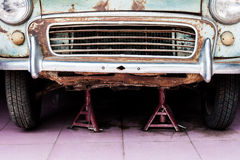 Detail of the front of an old car in garage Royalty Free Stock Photo