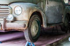 Detail of the front of an old car in garage Stock Image