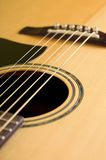 Detail of front side of acoustic guitar Royalty Free Stock Photo