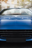 Detail of front side of a dark blue racing sport car Stock Photo