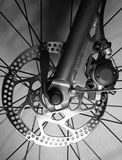 Detail of Front tire of a bicycle with disk brakes Royalty Free Stock Photo