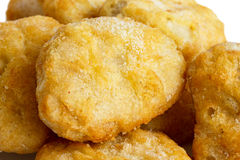 Detail of frozen battered chicken nuggets uncooked. Royalty Free Stock Photos