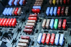 The detail of the fuse box in the car. ´s engine room. Many fuses with different values of current stock image