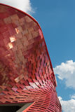 Detail of Futuristic Megastructure: Curve Red Building Facade Royalty Free Stock Image