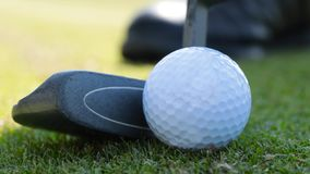 Detail of the game of Golf. Game of golf. Putter and Golf ball on green grass. UHD video stock footage