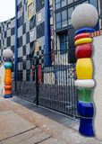 A detail of the garbage processing plant in Vienna. VIENNA, AUSTRIA - DECEMBER 4: gates of the garbage processing plant with columns designed by Hundertwasser royalty free stock image