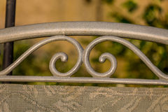 Detail of garden chair. Close up detail of scrollwork on a garden chair Royalty Free Stock Image