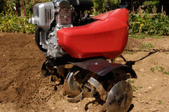 Detail of Garden tiller to work. Garden tiller to work, detail stock photo