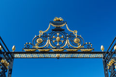 Detail of the gate against the blue sky Royalty Free Stock Photography