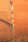 Detail of gate frame . Outdoor football or handball playground, light red clay Royalty Free Stock Photos