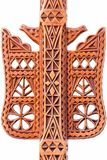 Detail on Genuine Handmade Wood Geometric Art decoration on an Isolated Distaff tool. A hand-made work of art of an folk artisan carved decoration in a single Stock Photo