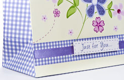 Detail of gift bag with flowers Royalty Free Stock Photography