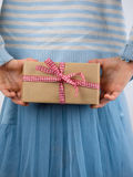 Detail of girl holding present behind back stock photography