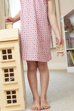 Detail Of Girl Playing With Dolls House In Bedroom Stock Photos