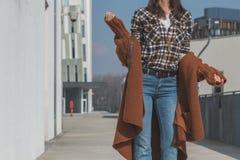 Detail of a girl posing in an urban context Stock Photos