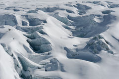 Detail of glacier flow and crevasses covered by snow in winter stock photo
