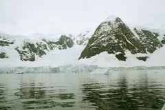 Detail, glacier flowing into ocean Stock Photos