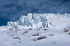 Detail of glacier seracs ice blocks crevasses illuminated by sun Royalty Free Stock Photography