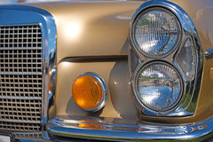 Detail of glamor retro car with headlight. Luxury, wealth, major - concept Stock Images